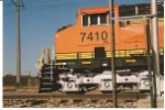 BNSF 7410 close up and personnel as she rolls south.