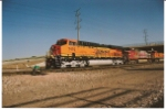 BNSF 7410 wide angled shot as she rolls south to CSprings, Co.