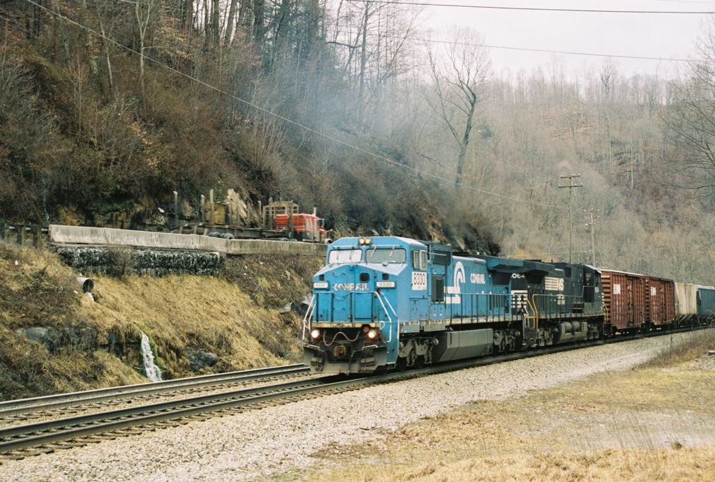NS 8330 with it's Dash 9 helper charge uphill