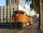 BNSF 4468 leads a train through town
