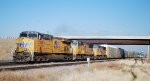 UP 7708 leads east auto rack/ double stack