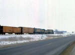 1129-27 Eastbound C&NW freight with Alco slug set