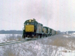 1129-36 Eastbound C&NW freight with Alco slug set
