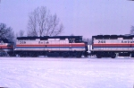 1125-31 Eastbound Amtrak Empire Builder on BN Willmar Line passes site of ex-GN Cedar Lake Receiving Yard