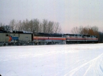 1125-33 Eastbound Amtrak Empire Builder on BN Willmar Line passes site of ex-GN Cedar Lake Receiving Yard
