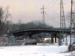 1125-34a Eastbound Amtrak Empire Builder on BN Willmar Line passes under Cedar Lake Pkwy bridge