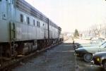 1147-02 Westbound BN freight passes Lake Minnetonka near Harts Cafe