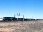 1152-29 Eastbound BN freight passes CTC Interstate