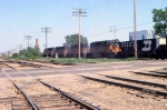 1165-16 Eastbound MILW freight crosses Wooddale Ave
