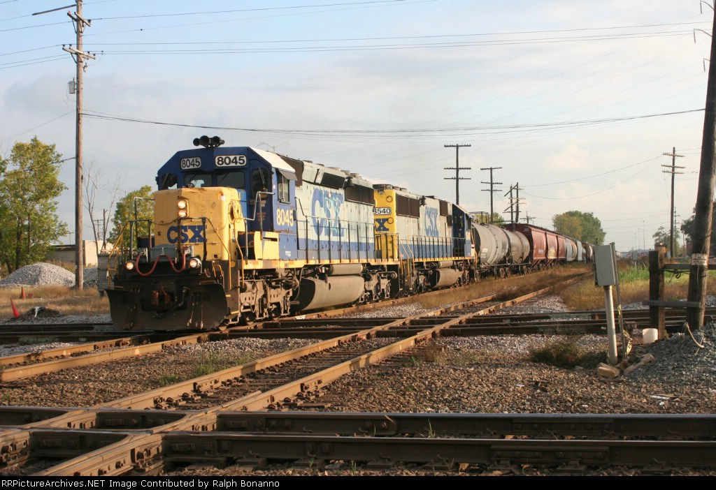 Running on the UP on trackage rights, a northbound CSX train  hits the diamonds
