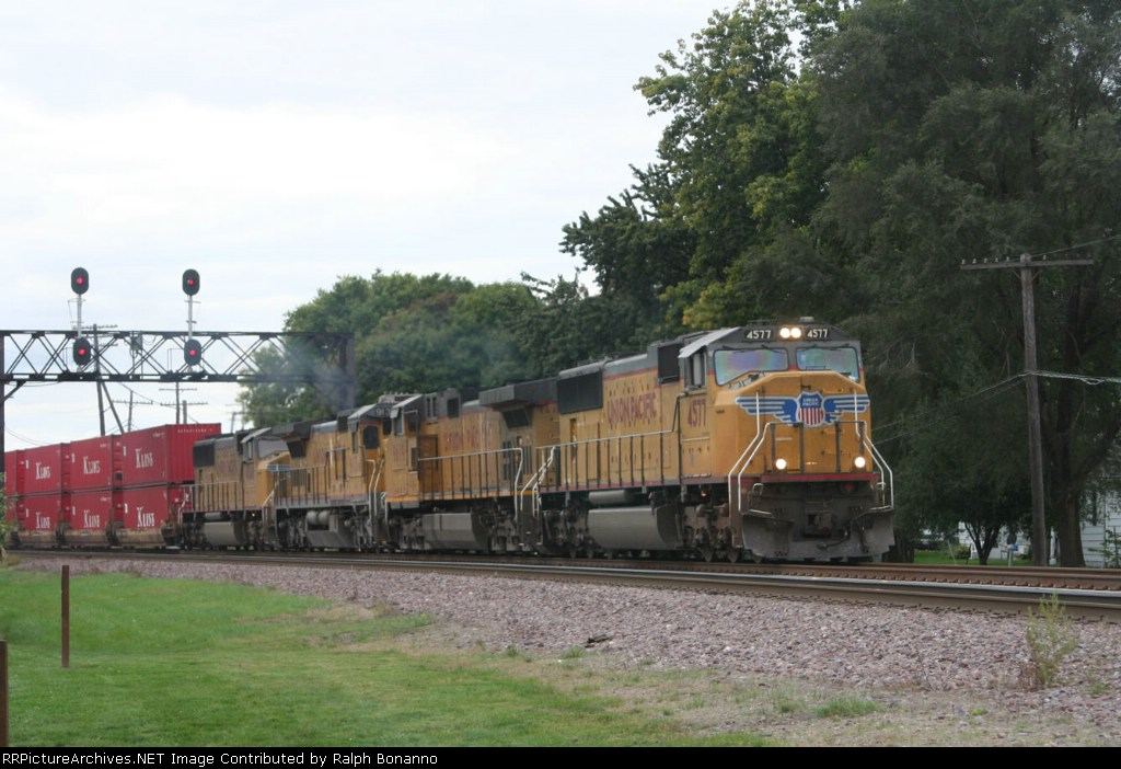 A four unit stack train rolls east across the BNSF and under the home signal