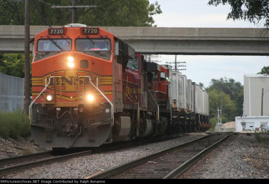 a westbound Z train rumbles through town under threatening skies