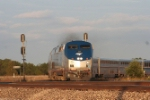 Amtrak's Southwest Chief comes off the connection track and heads west into the sunset
