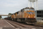Westbound tonnage with a pair of EMD's approaches the 9th st crossing