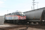 Westbound METRA train from the city passes a slow moving frieght as it approaches the Franklin Park Station