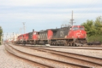 A CN train with a host of horspower starts around the connection from the yard