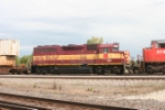 With a slightly fading paint job, WC GP40 3006 rolls past in the consist of a CN train