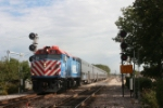 Midday METRA train from the city pulls into the station on the ex MILW mainline