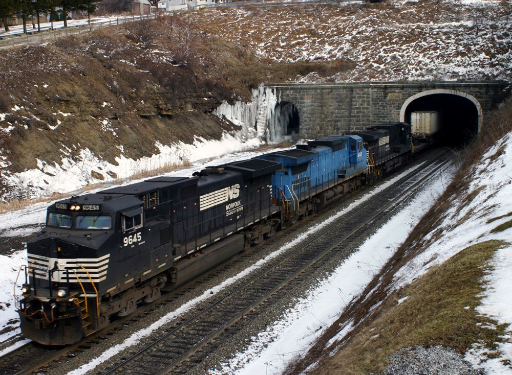 A Westbound stack train exits the tunnel at Galitzin, PA
