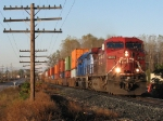 CP 9633 leads X500-20 eastward next to Chicago Drive on a crisp autumn morning