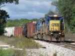 CSX 7612 & 7568 power Q326-02 eastward through the day's only spot of sunshine