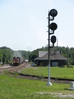 Q377 rolls through a work zone as it passes the old NYC station