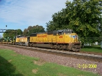 UP 4118 with help of switcher leads eastbound freight
