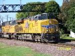 UP 7735 leads train east
