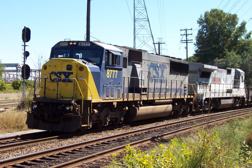 One of the familiar Q series trains comes pulling in with a RELIC for a helper