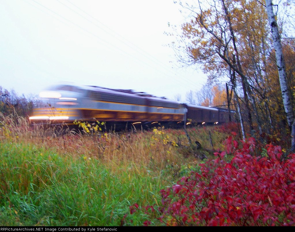 The Royal Canadian Pacific streaks past before sunrise