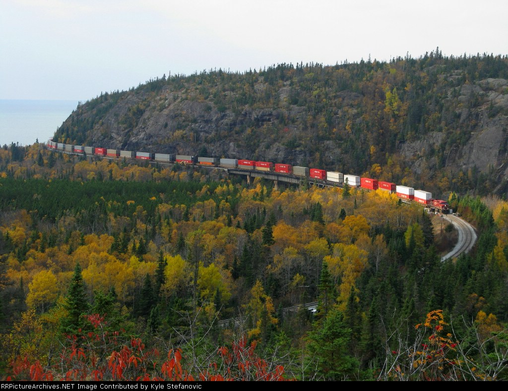CP intermodel Train running in front of the Royal Canadian Pacific