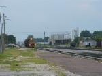 A Loram railgrinder comes speeding through town