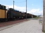 A Loram railgrinder speeding through town
