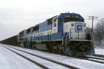 EMDX 9069 ice covered Oakway Lease Unit with eastbound coal loads