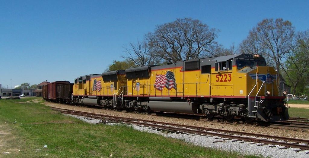 A pair of UP SD70M's holding down the Dothan CSX switch engines job.  Old ACL passenger station in background