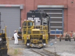 A worker looks over NS 5110 as it is moved out of the shops