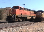 BNSF 7556 Rounds the Corner into Monolith