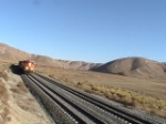 BNSF 7556 Headed NB in monolith
