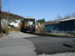 NS 8751 heads west with an empty hopper train on the CV main line in Bluefield, VA.