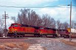 BNSF 4899 leads big brown west