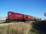 ILSX 1390 Sits With a Short String of Covered Hoppers at the NKCR-BNSF Interchange
