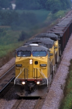 UP 7039, GE AC4460CW convertible, westbound empty hopper train