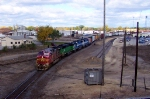 BNSF 690 leads a rainbow of power eastbound after a crew change