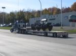 A set of trucks are traveling along Chestnut Street