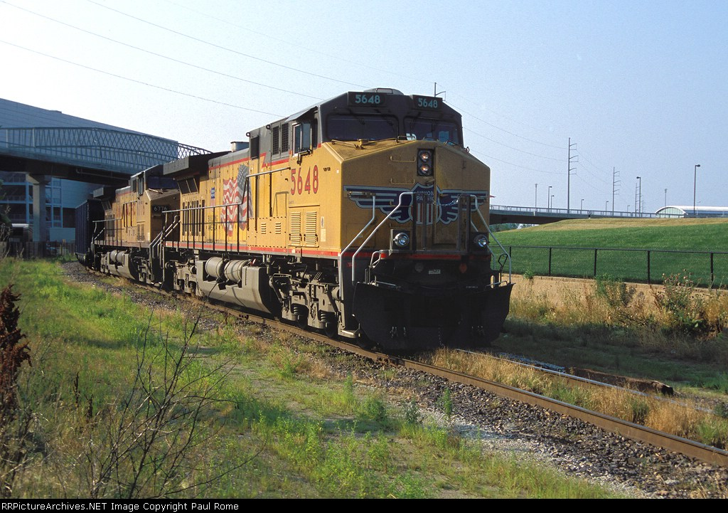 UP 5648 and 6776 lead the OPPD coal train empties past the Qwest Center