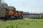 BNSF Wedgies, 5831 - 5994 lead a westbound empty hopper train past a UP Ballast Train