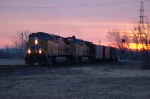 UP 6063 and UP 6048 are westbound with Mid-America Energy coal empties at sunrise