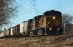 UP 6836 and SP 163 have an eastbound grain train in tow past the brick paved stretch of the old Lincoln Highway