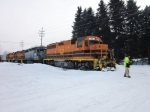 Crewman checks the crossing for ice buildup as RSR 102 leads the train across