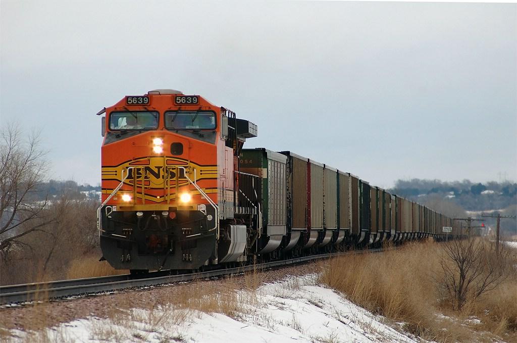BNSF 5639, AC44CW, leads a westbound empty hopper train